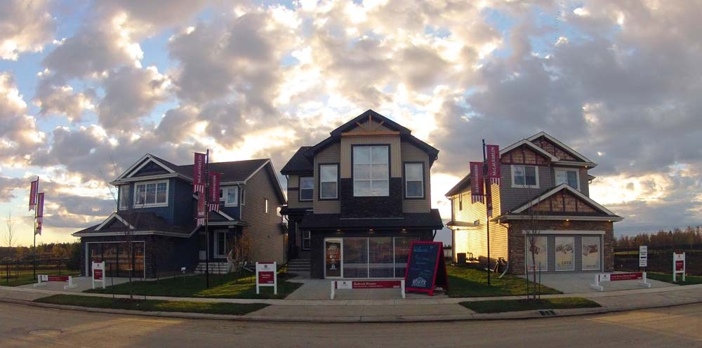 These Rosenthal showhomes are glowing in the light of the sunset. A flurry of clouds overhead, these high quality new builds in West Edmonton are new homes available for sale.