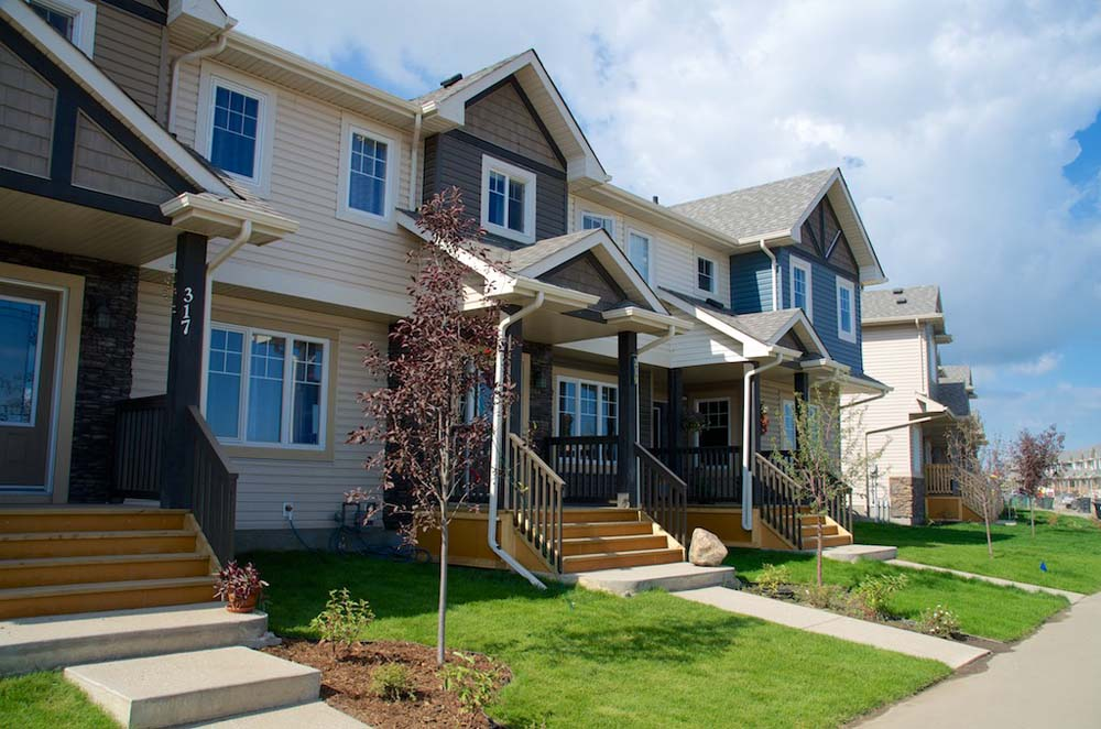 Townhomes in McLaughlin community are warm, welcoming, with beautiful entryways and front yards that are nicely landscaped. These homes are move in ready!