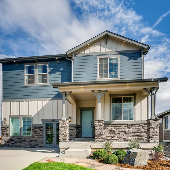 A large two storey home with vinyl siding and stonework in Harmony.