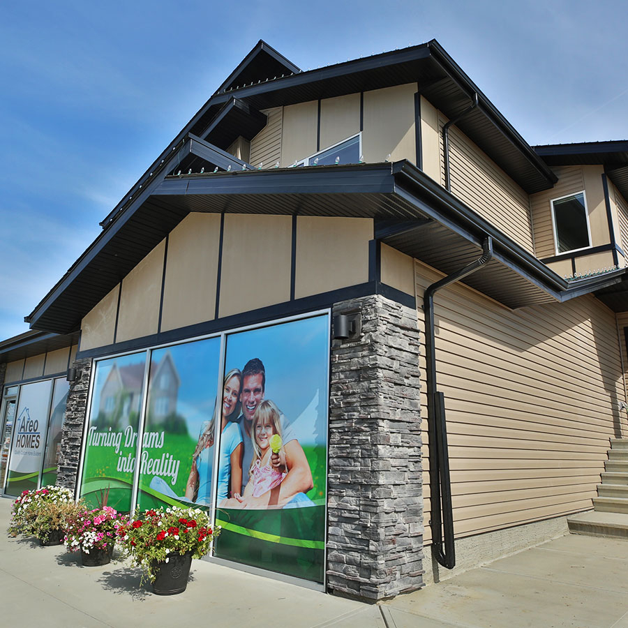Side view of the duplex showhome by Areo Homes located in West Haven Park in Leduc